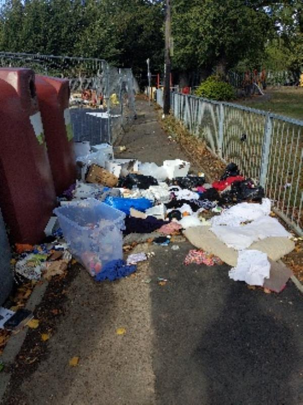 rubbish all across the pavement next to recycling bin-The Malthouse 120-124 Chatham Street, Reading, RG1 7HT