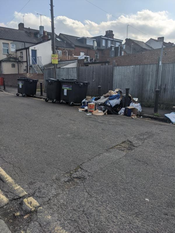Fly tipped rubbish near bins (which really should not be kept on the public highway!!!!!) -2 Amity Road, Reading, RG1 3LJ