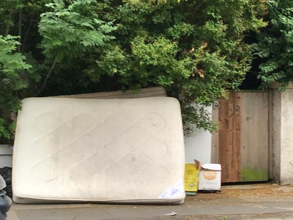 Mattresses and bags of cement outside 24 Honley Road-21 Honley Road, London, SE6 2HY