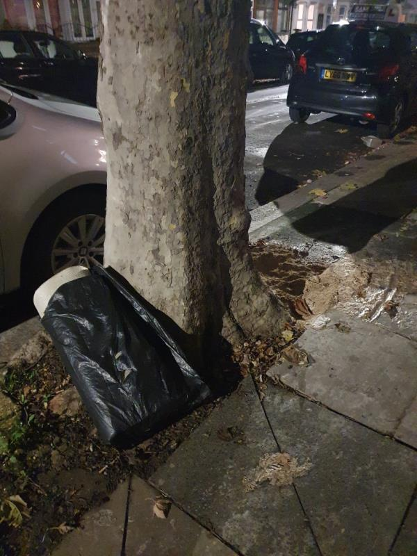 lots of flour making a sludge on the payment as well as rubbish bag dumped-49 Lansdown Road, Upton Park, E7 8NF