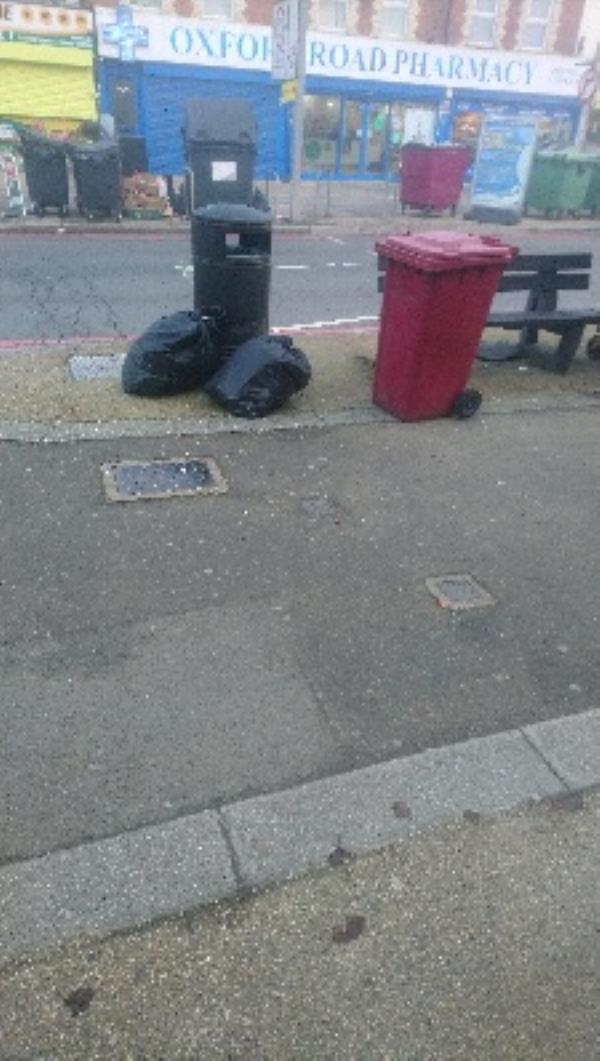 Black bin bags by litter bin-278a Oxford Road, Reading, RG30 1AD