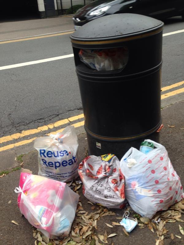 Overflowing bins on Southampton st by West hill bus stop. -140 Southampton Street, Reading, RG1 2QF
