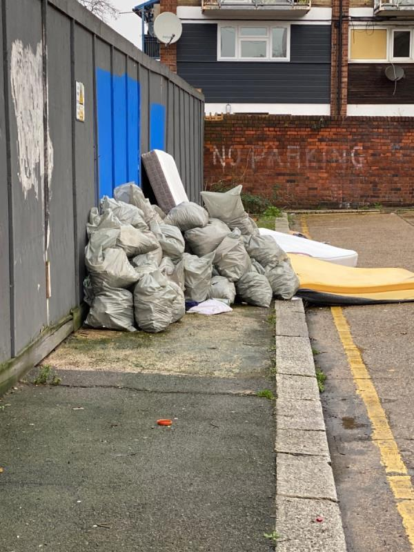 Commerical waste dumped illegally with mattresses (mattresses were here first for while, seems someone's added)-131 Angel Lane, London, E15 1DB