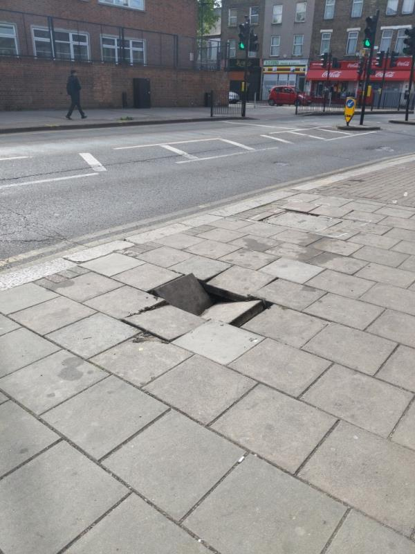 Big hole in the paving stones-130 Upton Lane, London, E7 9LW