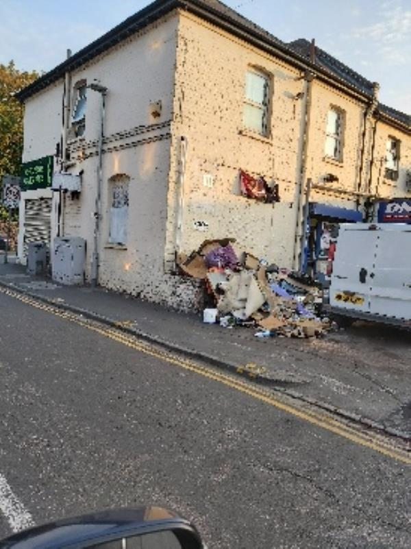 trade waste dumped next to garage. fire hazard-275 London Road, Reading, RG1 3NY