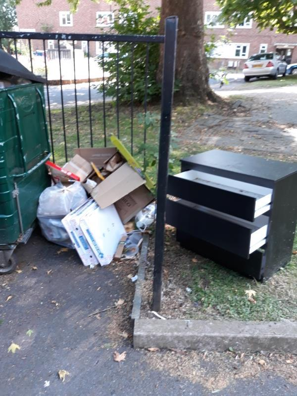 bags of rubbish and chest of drawers -23 Sheenewood, London, SE26 6BJ