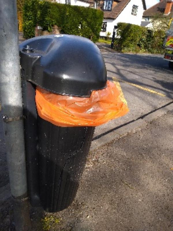 This litter bin is split and needs replacing. It's outside the hill school in old Peppard Road -163 Peppard Road, Reading, RG4 8TS