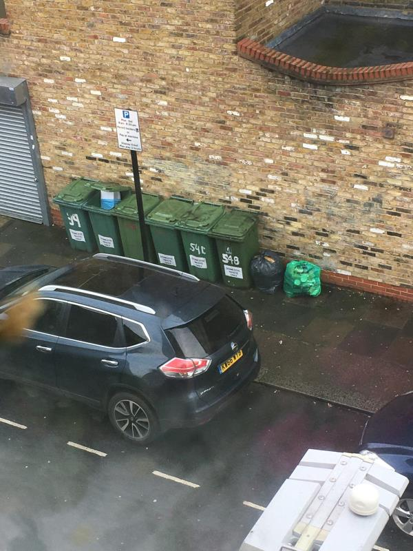 Bags beside bins, side of Coffee Hut, over the road outside flats all four bins full leading to fly tipping-1 Waterloo road E6 1AP