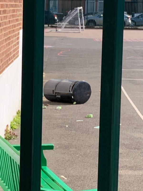 A bin tipped over in the school yard and although there are people in there, they are ignoring the mess. Don't want to get pests in the area on top of already being on lockdown! image 1-25 Upton Avenue, London, E7 9PN