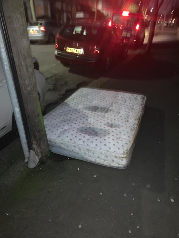 Mattress dumped on pavement opposite 9 Clarence road. -10 Clarence Road, London, E12 5BB