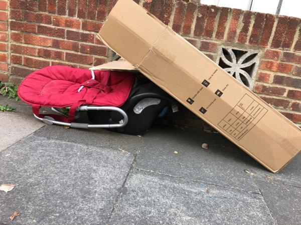 Baby bouncer, car seat and box outside number 26 Credon-24 Credon Rd, Plaistow, London E13 9BJ, UK