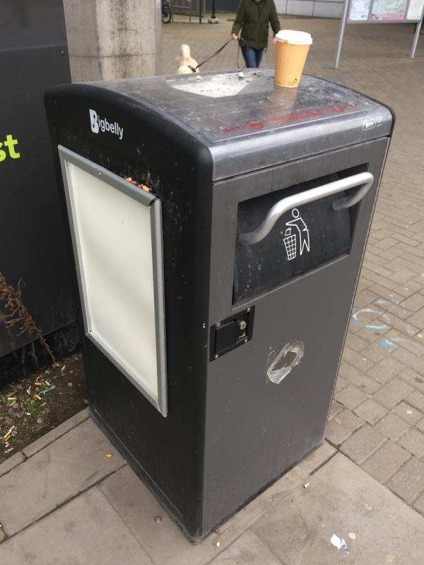 This bin does not have a cigarette facility and as you can see it is leading to cigarettes being left on the floor, surrounding area and on the bin itself. I notice that two of the same type of bins at pontoon dock dlr station do have an attachment for cigarette disposal. This same facility should be added to this bin. This has been raised before as part of Job code 1499072 with the case closed despite no cigarette facility having been added. -North Woolwich Road, London, E16 2AT