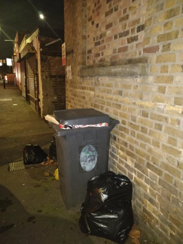 Dumped black bag of rubbish on the pavement beside the garage entrance on Maryland Road off Leytonstone Road E15-129 Maryland Street, London, E15 1JD