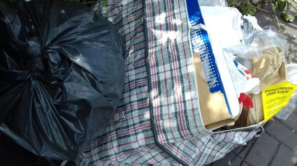 A black bag and a domestic bag full of rubbish dumped opposite 36 Winter Avenue -36 Winter Avenue, East Ham, E6 1NY