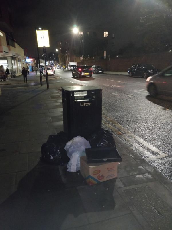 Dumped black bags of rubbish on the pavement beside 91-97 Leytonstone Road E15-89b Leytonstone Road, London, E15 1JA