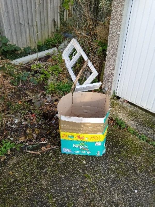 fly tipping by garage 38 Coronation square end of the road turn left -63 Virginia Way, Reading, RG30 3QR