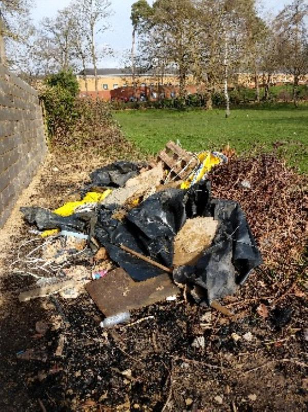 huge heap of flytipping prospect park near  honey end lane entrance, from garden with new wall-66 Honey End Lane, Reading, RG30 4EQ