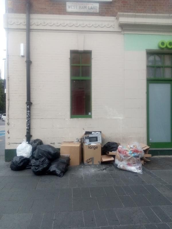 There are rubbish bags left on this spot -1 West Ham Lane, London, E15 4BQ