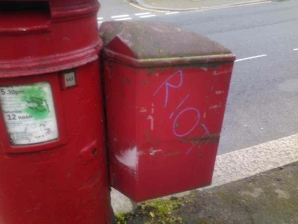 Green and purple graffiti is on the postbox on Lewisham Hill-42 Lewisham Hill, Lewisham, SE13 7EL