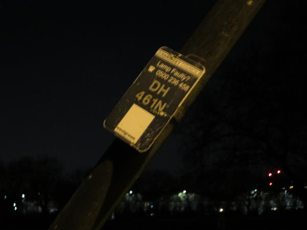TWO BROKEN STREET LIGHTS  - MAKING PATH THROUGH DOWNHILLS PARK VERY DARK,  and one street light pole collapsing and a potential danger to users of the park. -Downhills Park
