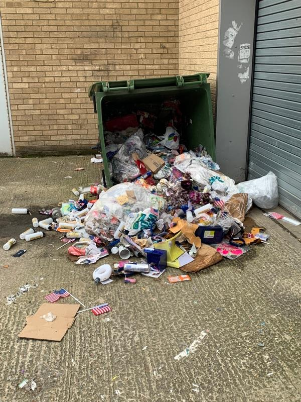 Upturned Bon and contents spilt from closed Poundland site -65 Eastmead, Farnborough, GU14 7SL