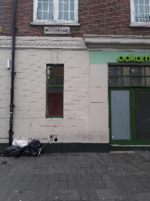 Fly-tipping, 35 West Ham Lane, Stratford Original Ambassador MK-31 Broadway, London, E15 4BQ