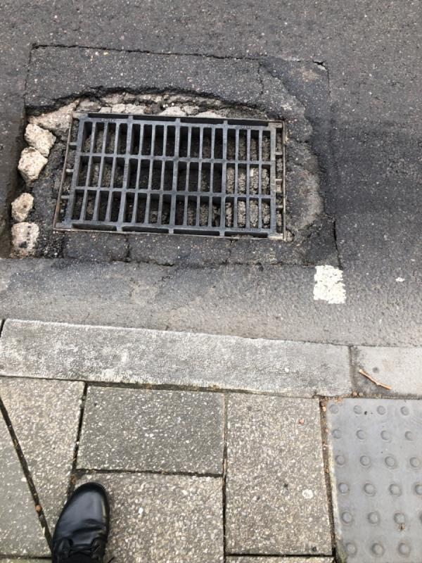 Gulley full of debris and re-in statement collapsing outside Coombes Croft library- High Rd N17-760 High Road, London, N17 0TU