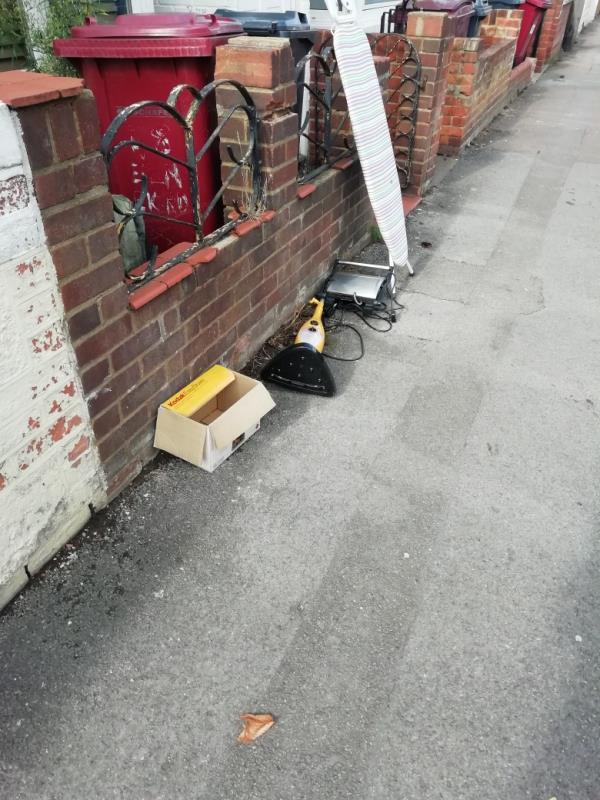 Fly tipping on pavement-48 Elm Park Road, Reading, RG30 2TN