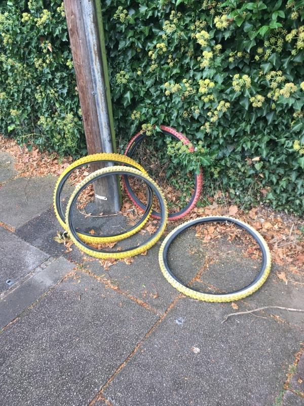 Fly tipping of bike tyres on Belvoir Drive, Aylestone. Tyres located close to junction with Aylestone Road. -Belvoir Court, 12 Belvoir Drive, Leicester, LE2 8PA