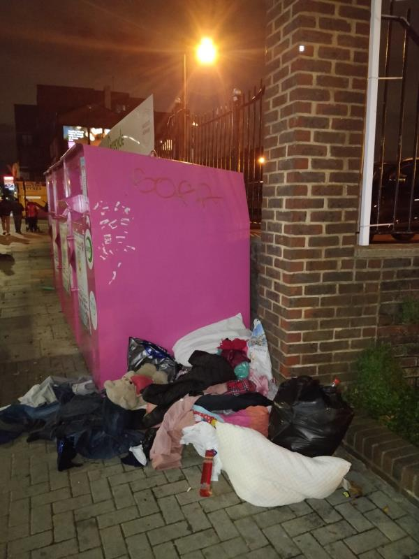 Dumped black bag of rubbish on the pavement and clothes strewn across the pavement at Henniker Point Leytonstone Road E15-Henniker Point Leytonstone Road, London, E15 1JY