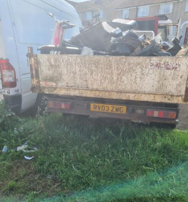 Ford Transit pickup style truck abandoned in parking area.  RV03 ZWG.  Vehicle has no Tax and NO INSURANCE!  Needs to be removed immediately.  Rubbish also piled up high on top of it.-62 Ringwood Road, Reading, RG30 6TX