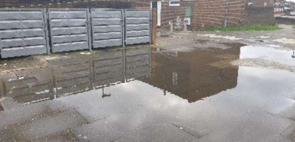 4 Caradon Way, London, N15 5EH. Drainage problems, rain water overflow in front of bin chamber nearby flat 4 Caradon way, N15 5EH. attention required. -4 Caradon Way, London, N15 5EH