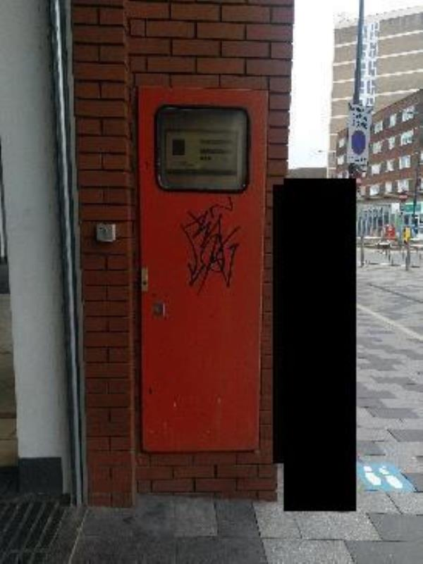 graffiti tag on alarm door on the from of the Charles Street entrance to the haymarket-Haymarket Shopping Centre, 1 Kildare St, Leicester LE1 3YH, UK