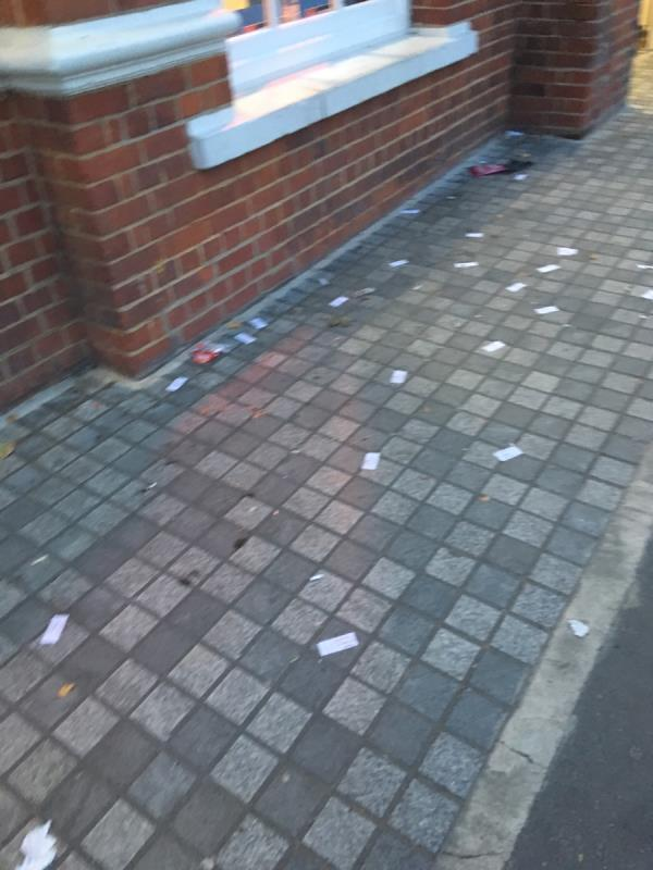 Prostitution cards thrown outside train station, road was swept , but then they ruined it-Forest Gate Railway Station Woodgrange Road, London, E7 0NE