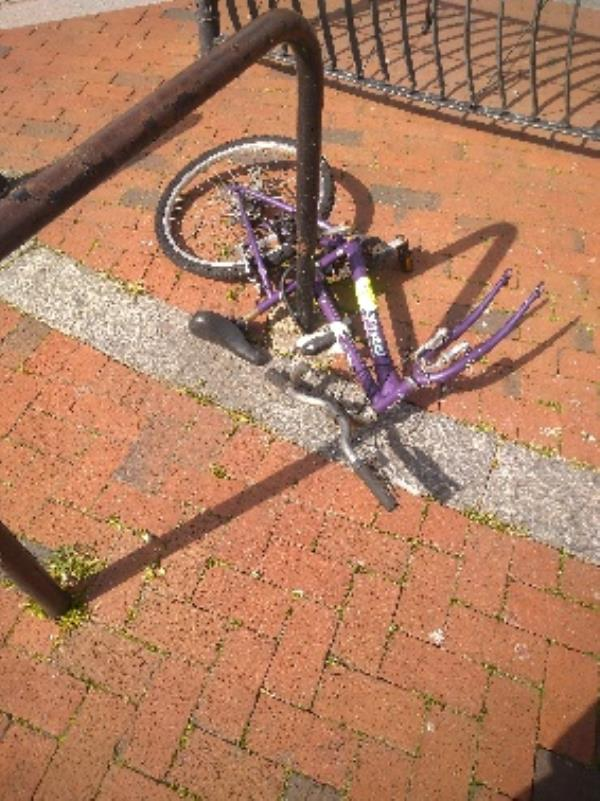 Bike is chained to railings  for several months-21 West Street, Reading, RG1 7JL