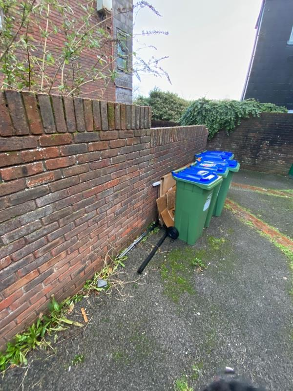Steel bed frame and large carton boxes dumped behind recycling bins since November 2020-7 Little East Street, Lewes, BN7 2NU