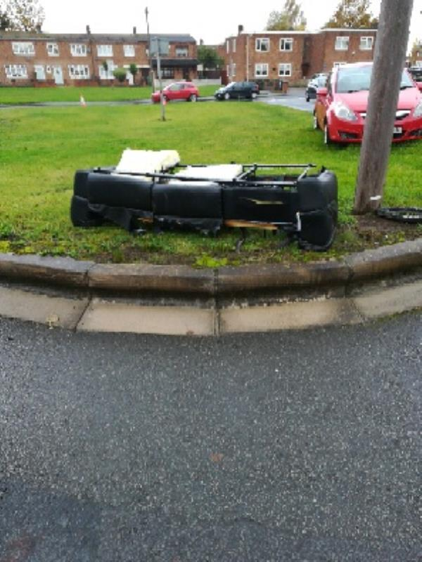 Sofa dumped Wallace Rd bradley-Geraghty Court, Willis Pearson Ave, Bilston WV14 8DQ, UK