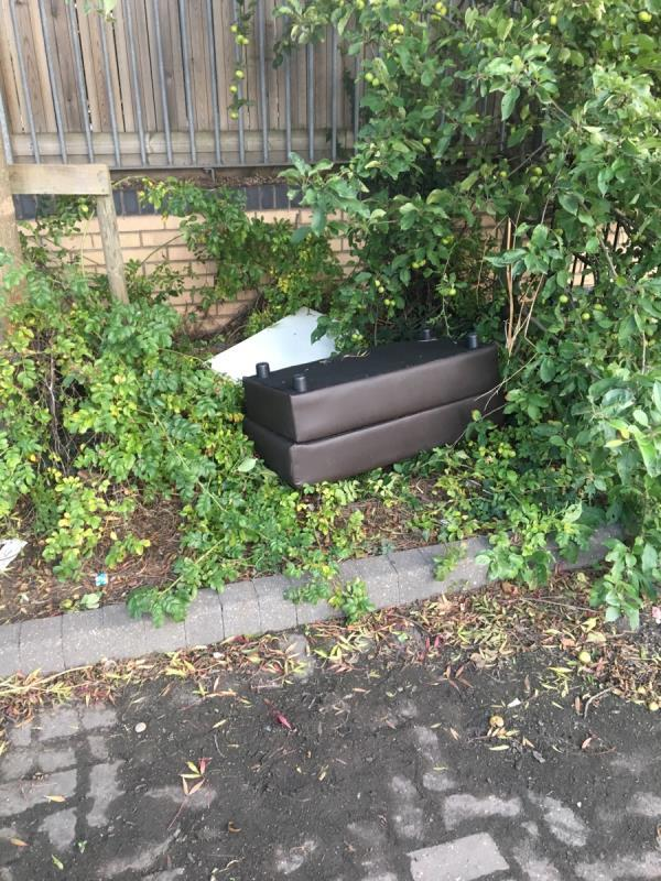 Dumped wood and furniture. In walkway to the side of Britannia Primary by small gate opposite basketball court.-23 Hanameel Street, London, E16 2AR