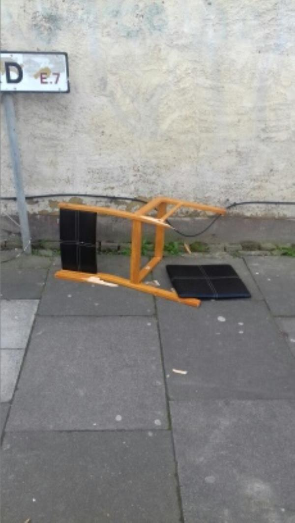 A broken dining chair dumped near 150 Green Street junction with Cheshunt Road -175a Green Street, London, E7 8JE