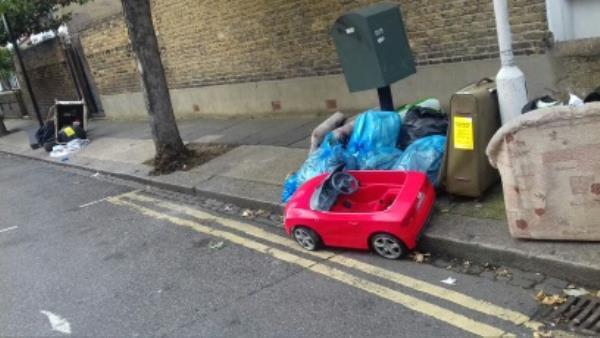Children toy, sofa, travelling bag, cardboard box, baby cot, tyre and several bags of domestic wastes dumped near 13 Credon Road junction with Southern Road -13 Credon Road, London, E13 9BS