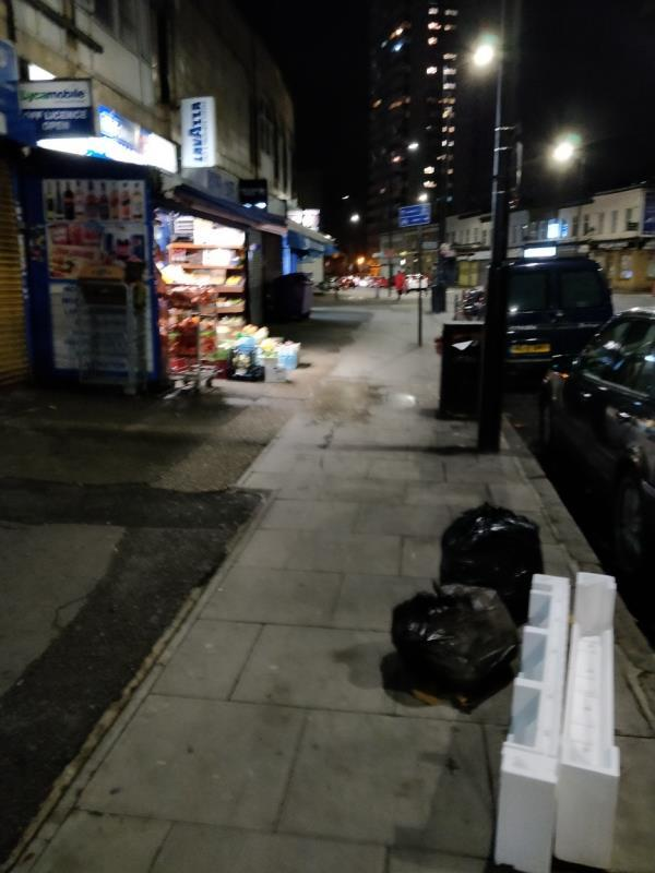 Dumped black bags of rubbish and polyester on the pavement beside 92 Leytonstone Road E15-92 Leytonstone Road, London, E15 1TQ