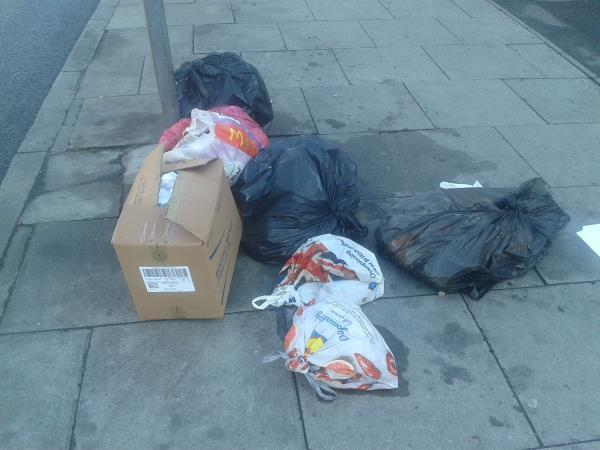Please clear dumped bags-259 Bromley Road, London, SE6 2RA