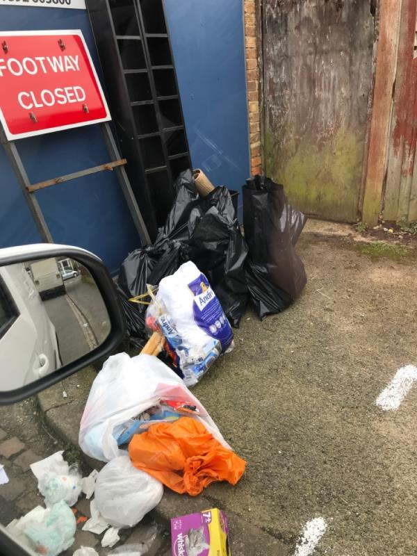Bags of tiles and wood -107 Winchfield Rd, London SE26 5TH, UK