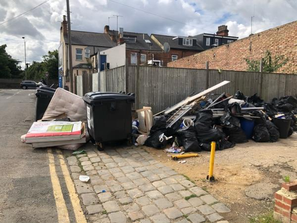 Load of rubbish on Amity Road near London Road. Obstructing public footpath -1-3 Amity Road, Reading, RG1 3LN
