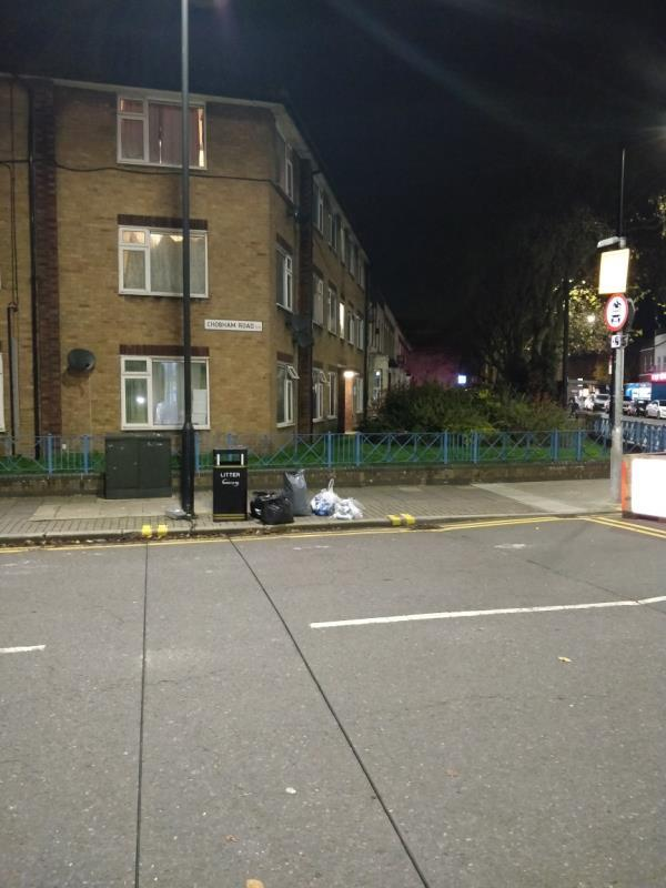 Dumped bags of rubbish on the pavement beside 2a Chobham Road off Leytonstone Road E15-159a Leytonstone Road, London, E15 1LH