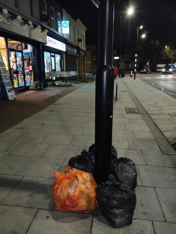 Dumped black bags of rubbish on the pavement beside 151 Leytonstone Road E15-147-149 Leytonstone Road, London, E15 1LH