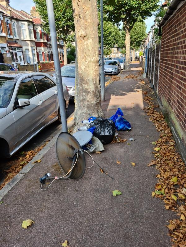 The bags of rubbish have now been added to with a couple of satellite dishes. Note this is on the Goldsmith Avenue part of this junction, so around the corner from the address on Essex Road. Rubbish is dumped here in the same spot every few days (as you'll see by the number of reports), presumably by the same people.-44 Essex Road, Manor Park, E12 6RE