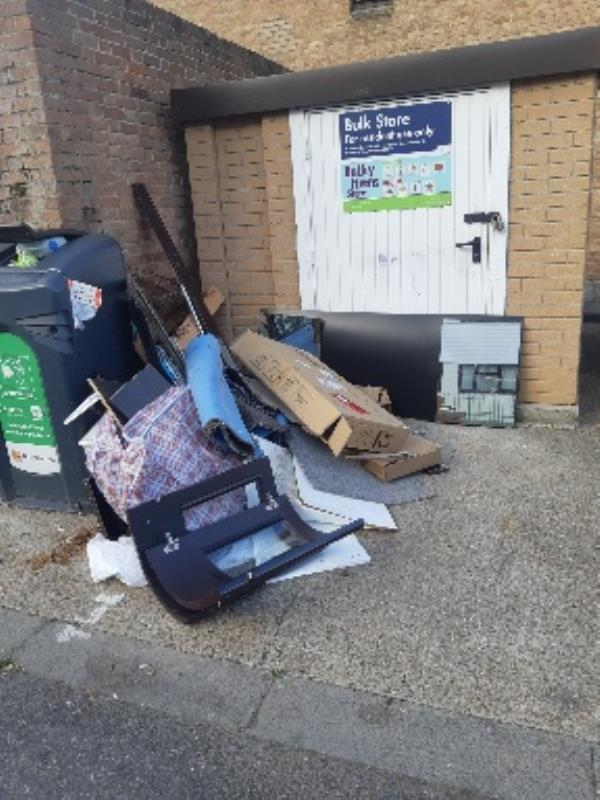 Dumps at the front of bulk store opposite 115 - 120,Hamilton Close, Tottenham, N17 9HW, need to be cleared/removed please,   -117 Hamilton Close, Tottenham, N17 9HW