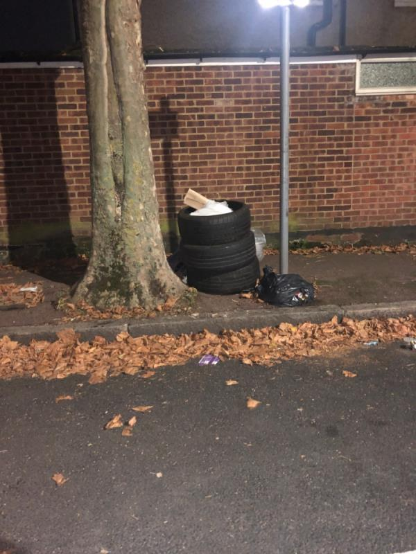 Discarded tyres and household rubbish-46 Essex Rd, London E12 6RE, UK