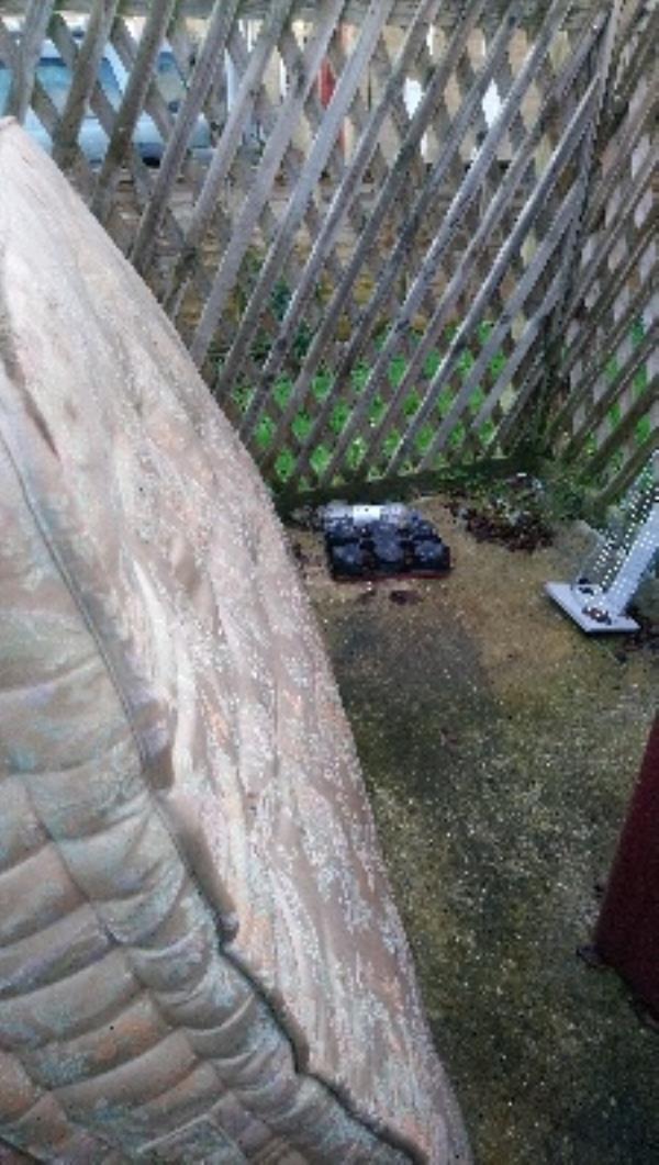 Fly tip in refuse area of 7-12 briony House heroes walk -Briony House, 1 Heroes Walk, Reading, RG2 8TY